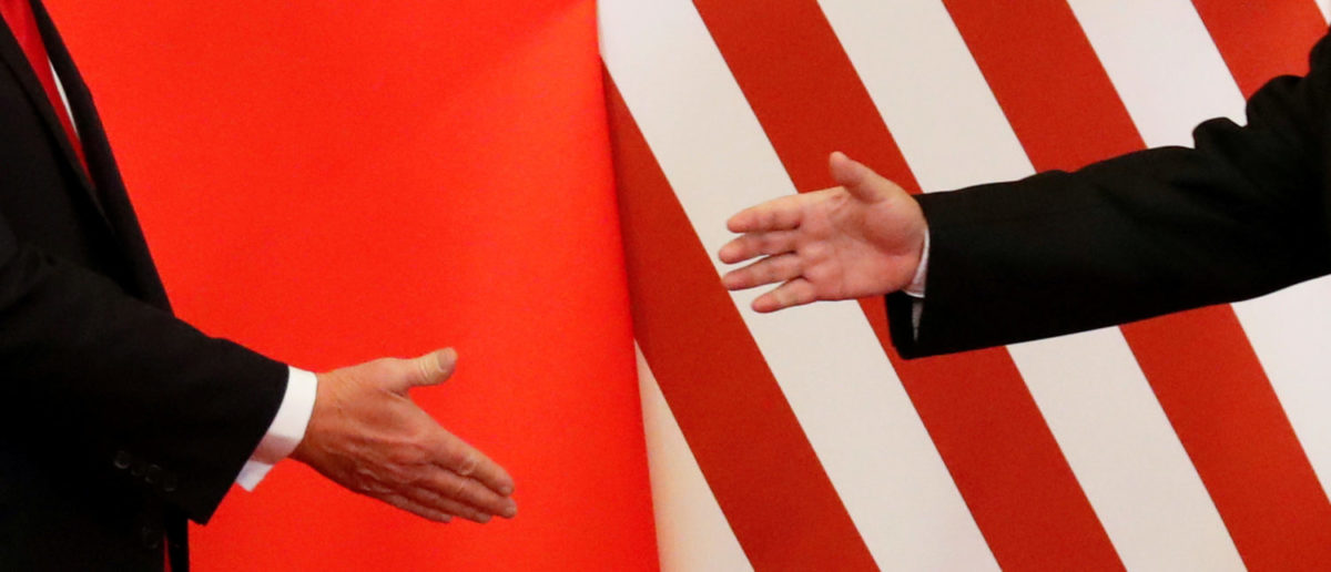 U.S. President Donald Trump and China's President Xi Jinping shakes hands after making joint statements at the Great Hall of the People in Beijing, China, November 9, 2017. REUTERS/Damir Sagolj TPX IMAGES OF THE DAY | Trump Shakes Up China Trade War ... Again