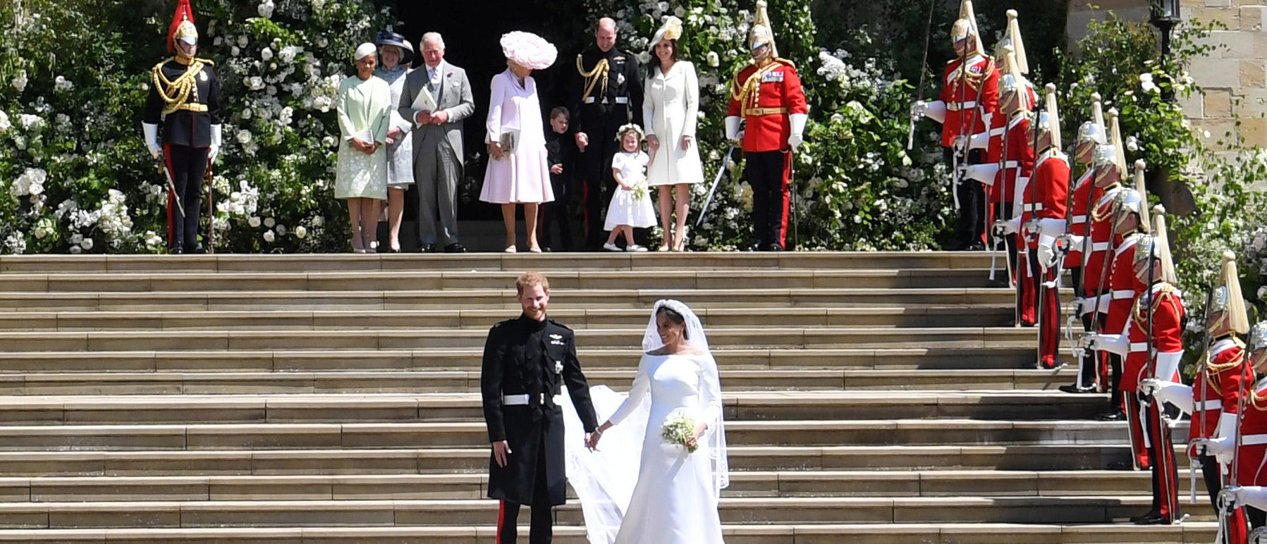Britain's Prince Harry (L), Duke of Sussex and Meghan (R), Duchess of Sussex exit St George's Chapel in Windsor Castle after their royal wedding ceremony, in Windsor, Britain, 19 May 2018. The couple have been bestowed the royal titles of Duke and Duchess of Sussex on them by the British monarch. NEIL HALL/Pool via REUTERS - RC13A9C94CA0