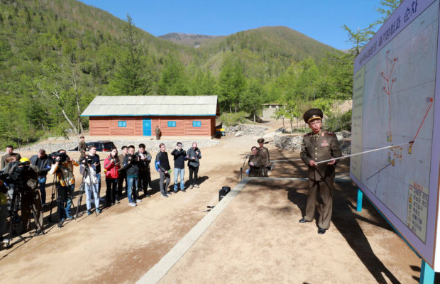 A North Korean official explains the procedure and process of dismantling Punggye-ri nuclear test ground before they blow up the facilities in Punggye-ri, North Hamgyong Province, North Korea May 24, 2018. Picture taken May 24, 2018. News1/Pool via REUTERS