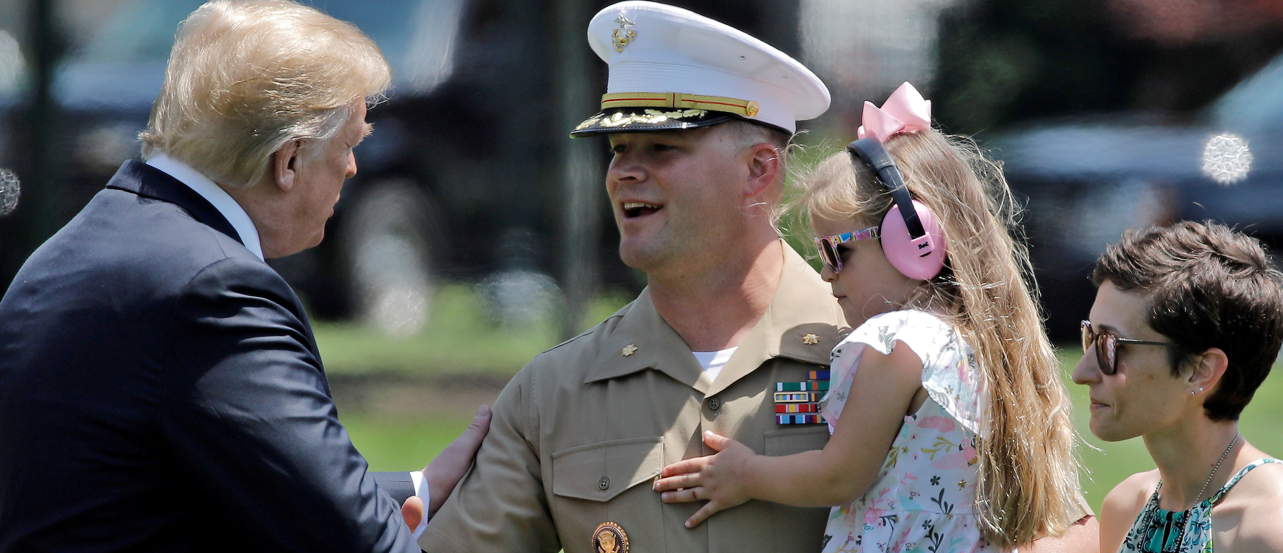U.S. President Donald Trump greets Marine One pilot Major Adam Horne and his family during Horne's last day on the job after returning from a trip to Annapolis, Maryland, in Washington, U.S. May 25, 2018. REUTERS/Carlos Barria - RC12CCE93000