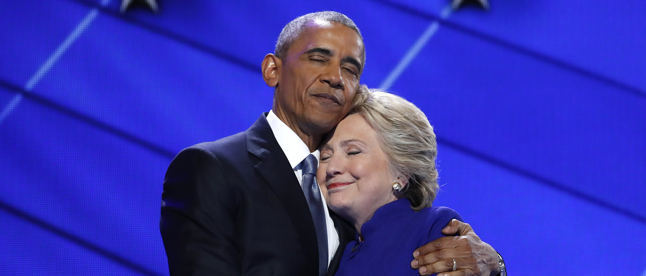Democratic presidential nominee Hillary Clinton hugs U.S. President Barack Obama as she arrives onstage at the end of his speech on the third night of the 2016 Democratic National Convention in Philadelphia, Pennsylvania, U.S., July 27, 2016. REUTERS/Jim Young TPX IMAGES OF THE DAY - HT1EC7S0FJSV9