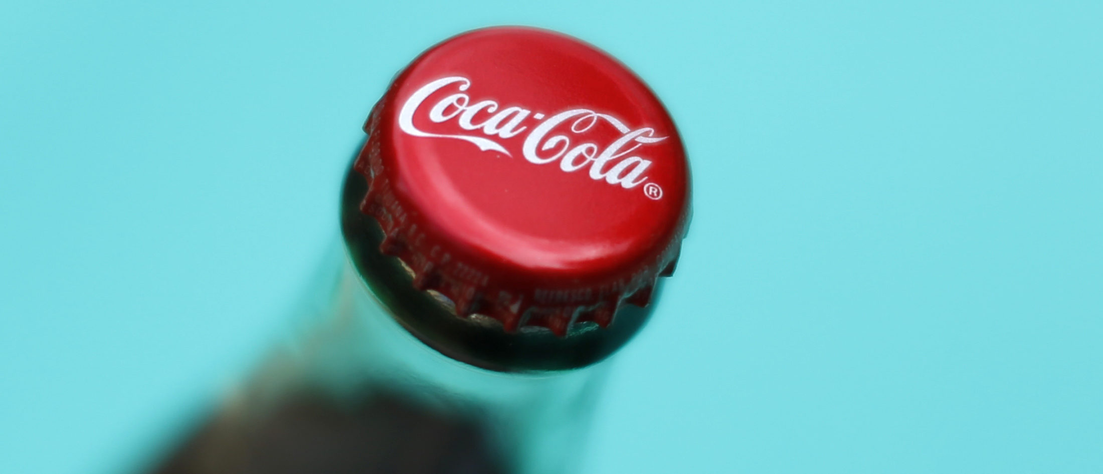 A bottle of Coca-Cola is shown in this photo illustration in Encinitas, California October 10, 2013. The Coca-Cola Company will report 3rd quarter earnings October 15. REUTERS/Mike Blake