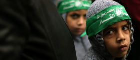Palestinian children wearing Hamas headbands take part in a rally against U.S. President Donald Trump's decision to recognize Jerusalem as the capital of Israel, in Khan Younis the southern Gaza Strip January 26, 2018. REUTERS/Ibraheem Abu Mustafa