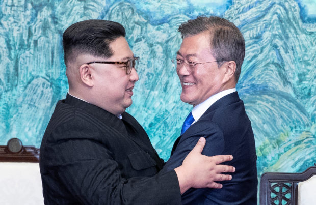 South Korean President Moon Jae-in and North Korean leader Kim Jong Un embrace at the truce village of Panmunjom inside the demilitarized zone separating the two Koreas, South Korea, April 27, 2018. Korea Summit Press Pool/Pool via Reuters