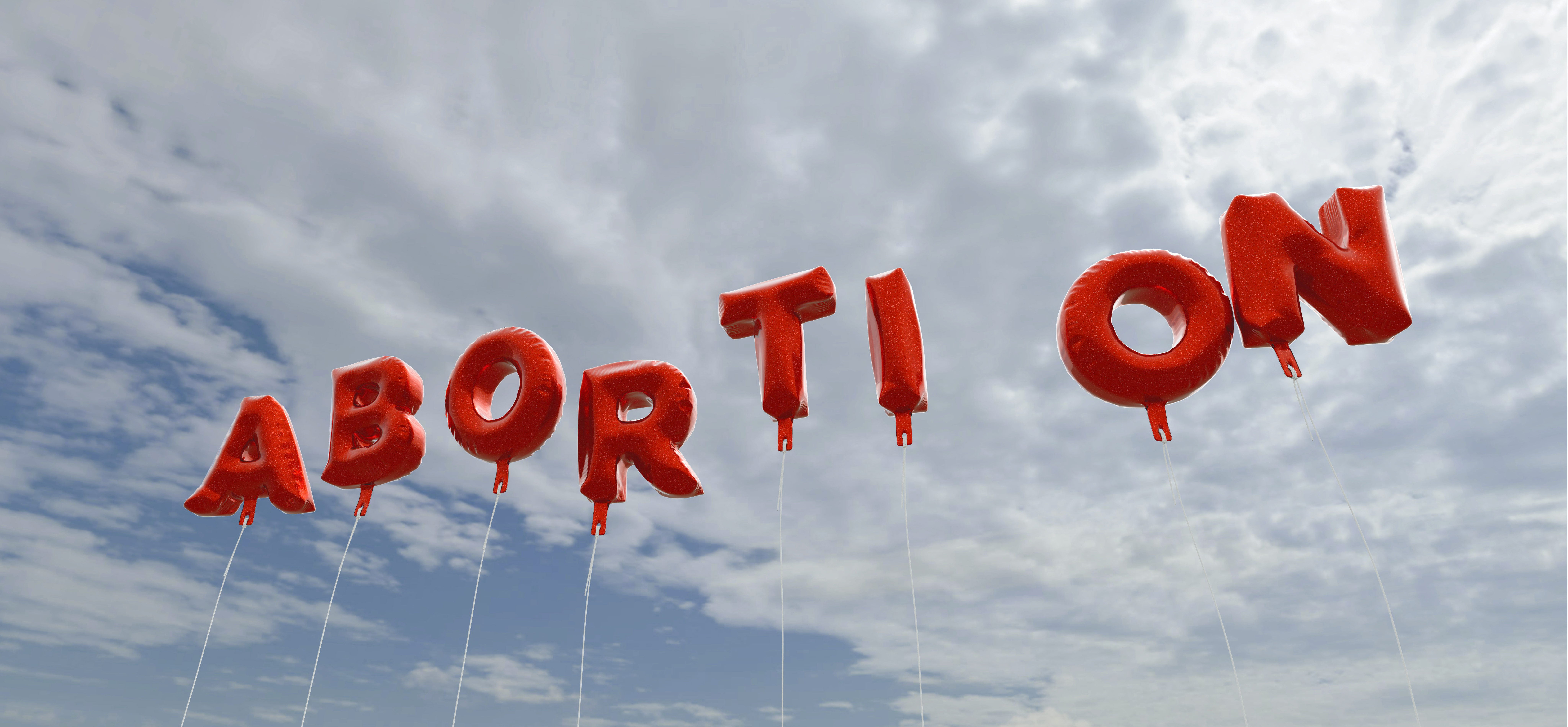 Red abortion balloons in the sky (Shutterstock/christitzeimaging)