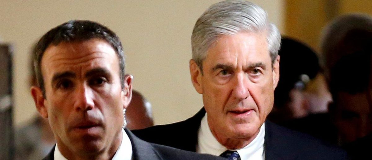 FILE PHOTO: Special Counsel Robert Mueller (R) departs after briefing members of the U.S. Senate on his investigation into potential collusion between Russia and the Trump campaign on Capitol Hill in Washington, U.S., June 21, 2017. REUTERS/Joshua Roberts/File Photo | Mueller Investigating Trump Inauguration