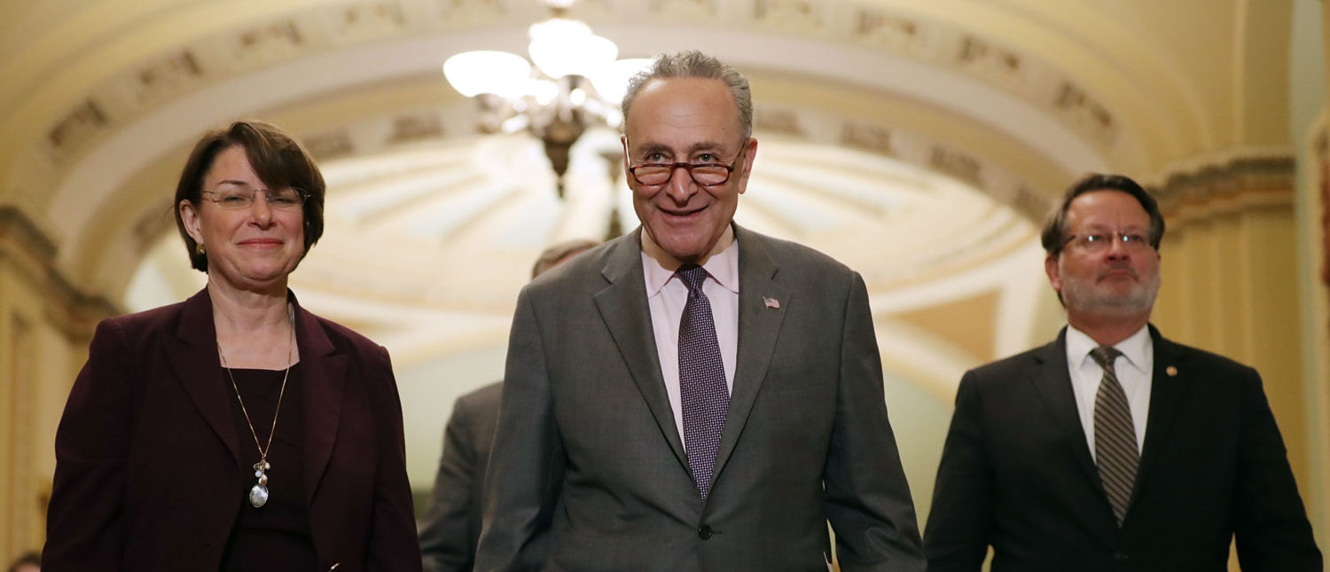 WASHINGTON, DC - MAY 15:  (L-R) Sen. Amy Klbuchar (D-MN), Senate Minority Leader Charles Schumer (D-NY) and Sen. Greg Peters (D-MI) prepare to talk to reporters following the weekly Senate Democratic policy luncheon at the U.S. Capitol May 15, 2018 in Washington, DC.  U.S. President Donald Trump joined Senate Republicans during their luncheon and talked about the robust economy and the opening of the new U.S. embassy in Jerusalem.  (Photo by Chip Somodevilla/Getty Images)