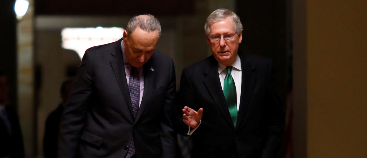 U.S. Senate Minority Leader Chuck Schumer (D-NY) and U.S. Senate Majority Leader Mitch McConnell (R-KY) walk to the Senate chamber on Capitol Hill in Washington, D.C., U.S., February 7, 2018. REUTERS/Eric Thayer