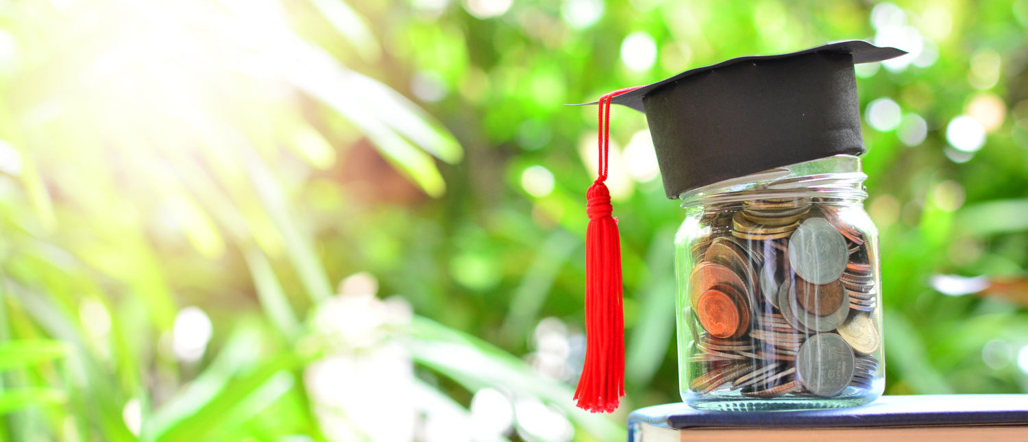 Coins saving set on books for concept investment education and scholarships (CREDIT: ITTIGallery/Shutterstock)