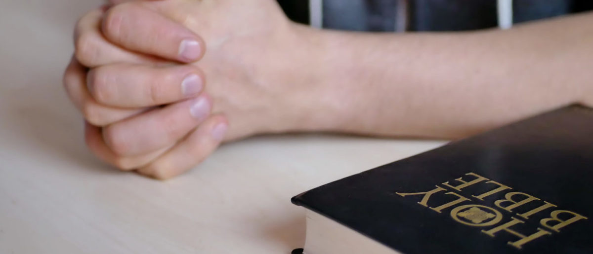 Student_With_Bible (Shutterstock/ Anatolii Mazhora) | School Accused Of LGBT Discrimination