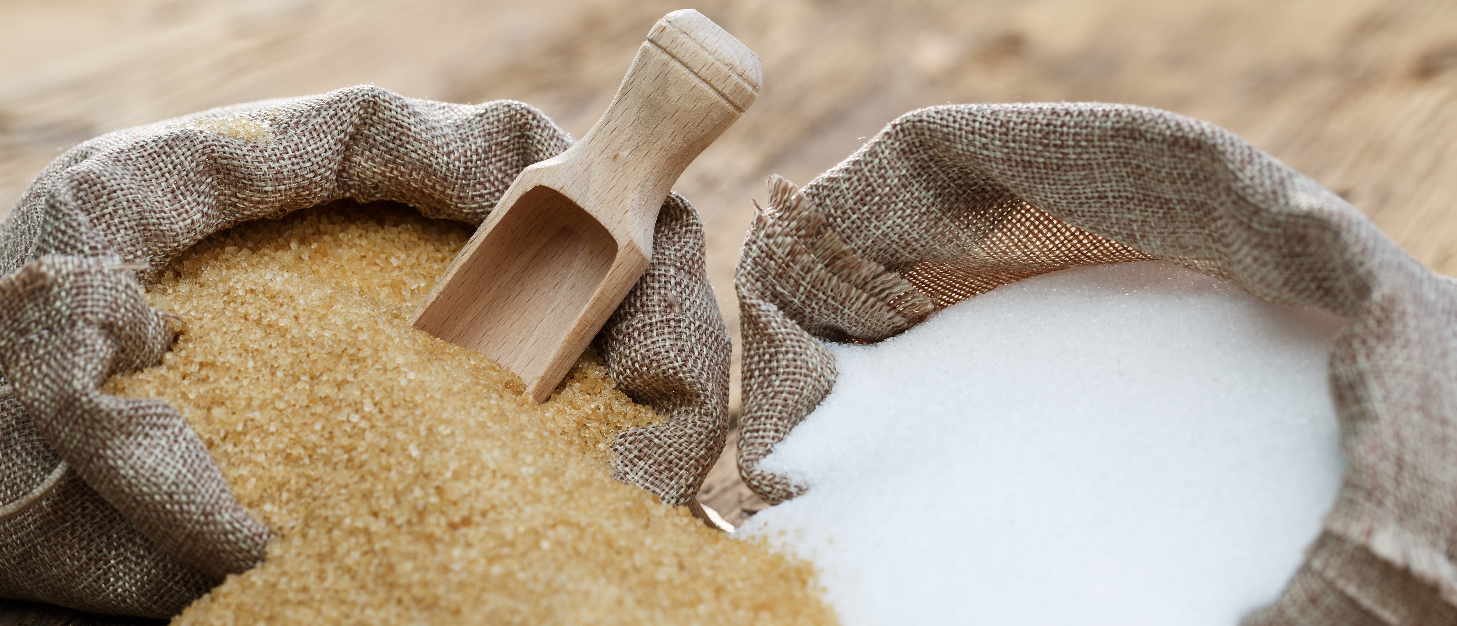 Various types of sugar, brown sugar and white. Shutterstock
