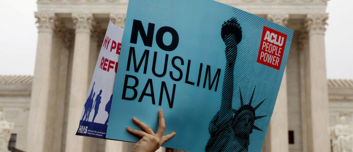 FILE PHOTO: Protesters rally outside the U.S. Supreme Court, while the court justices consider case regarding presidential powers as it weighs the legality of President Donald Trump's latest travel ban targeting people from Muslim-majority countries, in Washington, DC, U.S., April 25, 2018. REUTERS/Yuri Gripas   Disabled Yemeni Girl Reached U.S.