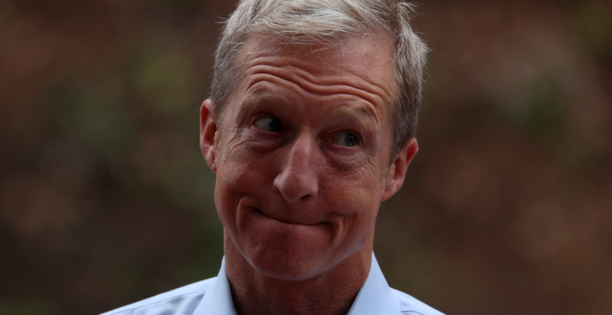 Political and climate activist Tom Steyer pauses as he speaks while taking part in a protest against U.S. President Donald Trump and Republican congressman Darrell Issa (R-Vista) outside Issa's office in Vista, California, U.S., October 31, 2017. REUTERS/Mike Blake | Tom Steyer Forces Renewables On Michigan
