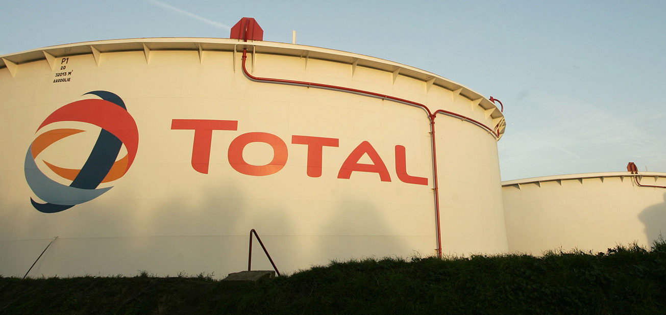 Gas containers featuring the Total corporate logo at the Total Refinery on November 23, 2006 in Antwerp, Belgium. Total Refinery Antwerp, the second largest refinery in Europe, is the largest and most complex refinery within the Total Group. Products are exported by sea-going vessels, trucks and pipelines from its location in the Port of Antwerp. (Photo by Mark Renders/Getty Images)