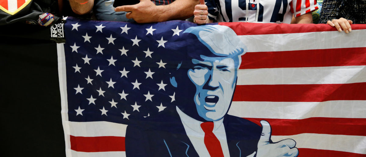 Supporters of U.S. President Donald Trump cheer as they wait for him to appear at a rally with supporters at North Side middle school in Elkhart, Indiana, U.S., May 10, 2018. REUTERS/Leah Millis