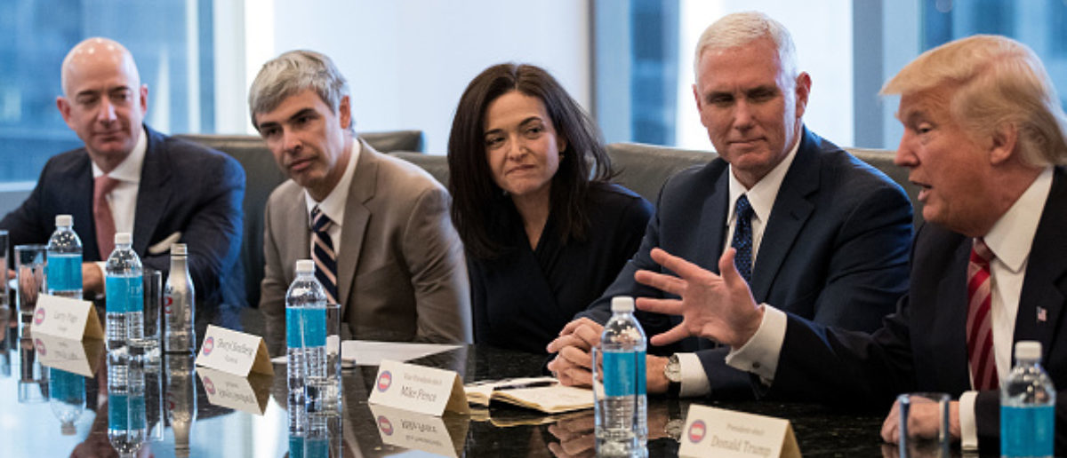 Amazon CEO Jeff Bezos, Google parent company Alphabet CEO Larry Page, Facebook COO Sheryl Sandberg, and Vice President-elect Mike Pence listen as President-elect Donald Trump in the first major meeting between President-elect Trump and technology industry leaders at Trump Tower, December 14, 2016 in New York City. (Photo: Drew Angerer/Getty Images)