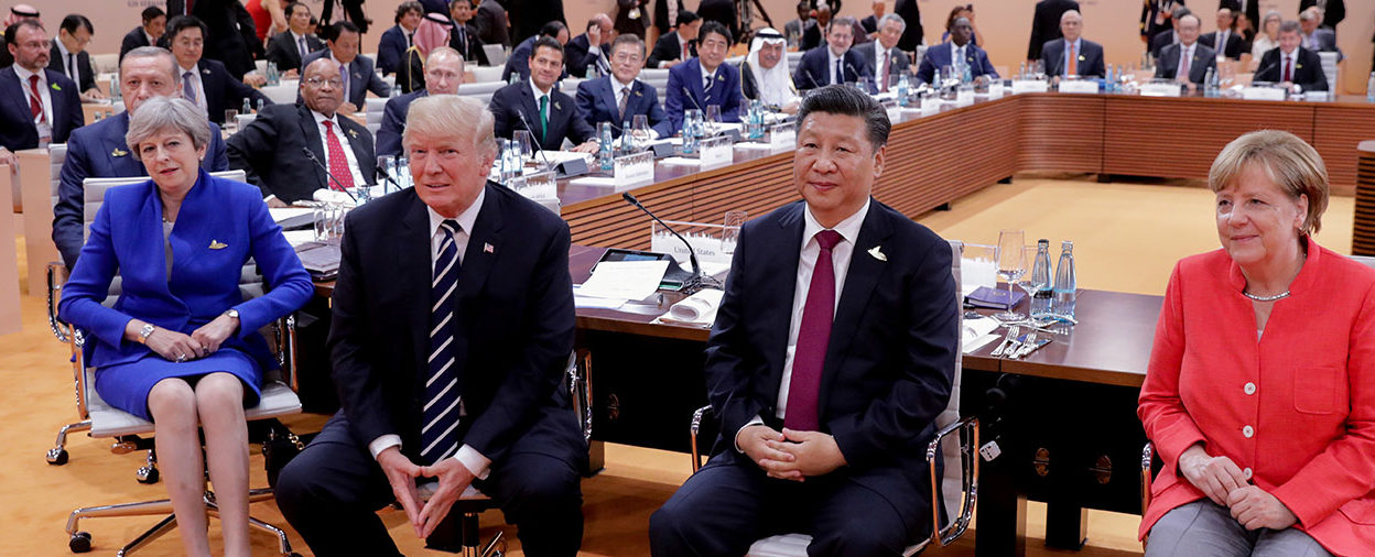 British Prime Minister Theresa May, US President Donald Trump, China's President Xi Jinping and German Chancellor Angela Merkel turn around for photographers at the start of the first working sessionthe G20 summit in Hamburg, Germany, July 7, 2017. Kay Nietfeld/Pool via REUTERS/File Photo - RC1933C55400