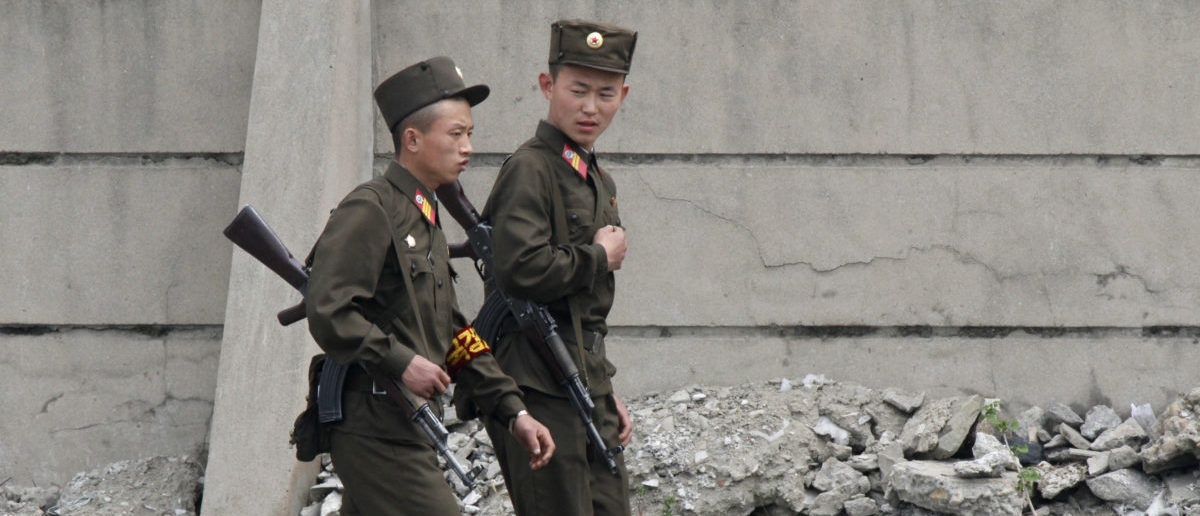 Armed North Korean soldiers patrol the banks of Yalu River near the North Korean town of Sinuiju, opposite the Chinese border city of Dandong, May 20, 2011. Confusion surrounded a North Korean visit to China on Friday, as media in the South said the North's leader Kim Jong-il had crossed the border, contradicting earlier reports that his son and heir apparent Kim Jong-un had travelled. REUTERS/Jacky Chen | North Korean Soldier Defects To South