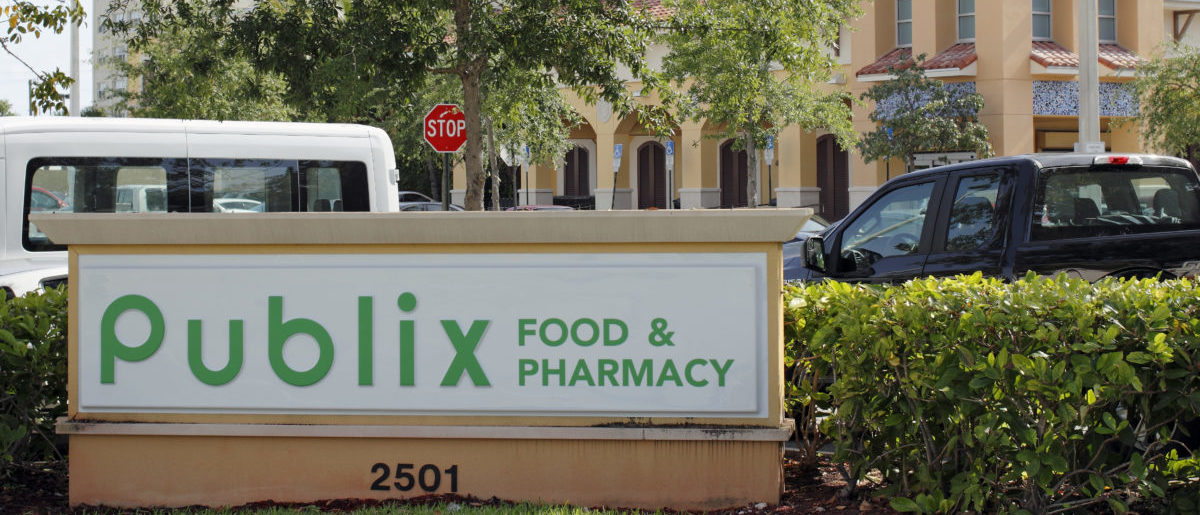 Two Publix Food & Pharmacy signs with a Publix grocery store. Publix grocery signs and supermarket on a sunny day -- ShutterStock -- Serenethos