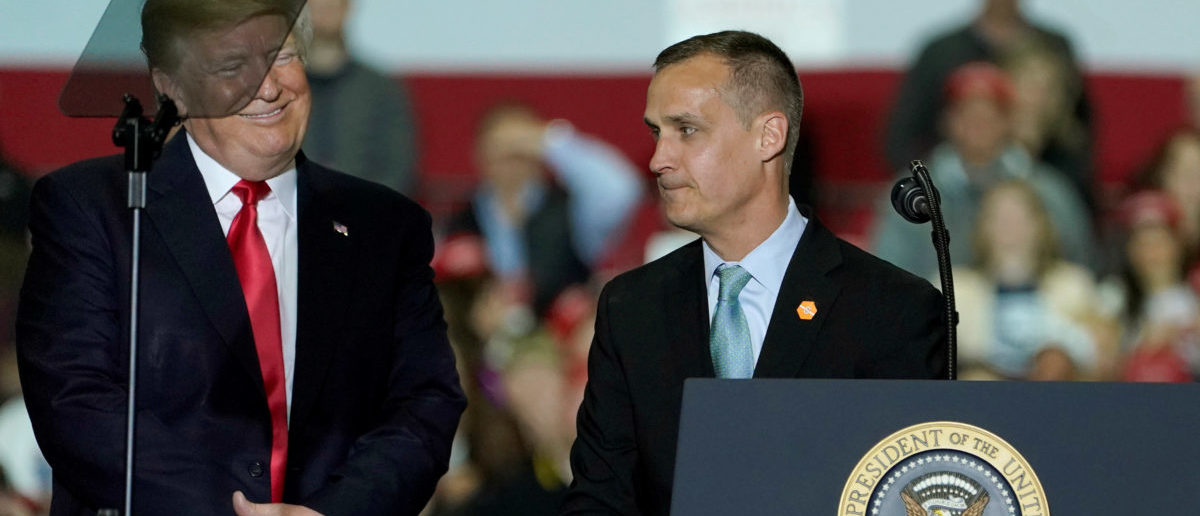 Advisor Corey Lewandowski stands with U.S. President Donald Trump during a Make America Great Again Rally in Washington, Michigan April 28, 2018. REUTERS/Joshua Roberts -