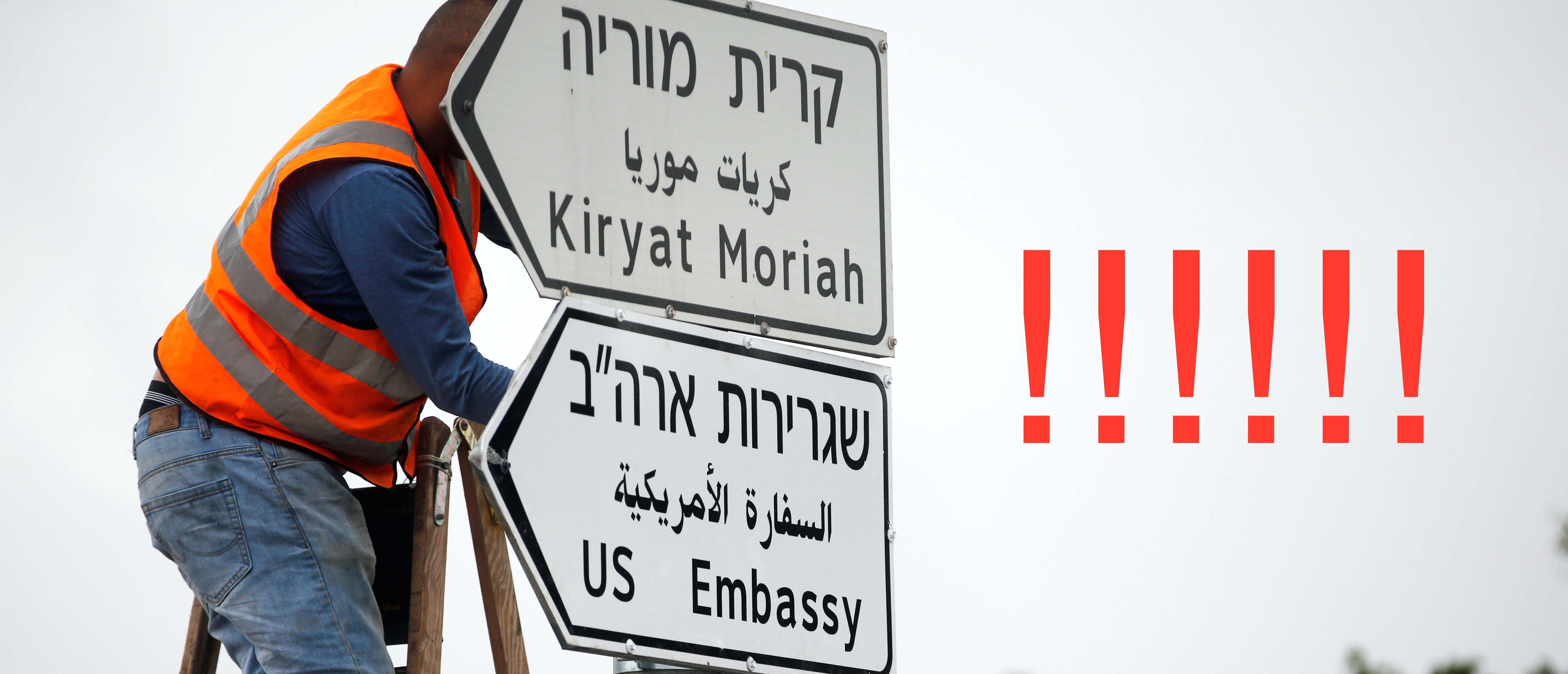 A worker hangs a road sign directing to the U.S. embassy, in the area of the U.S. consulate in Jerusalem, May 7, 2018. REUTERS/Ronen Zvulun -