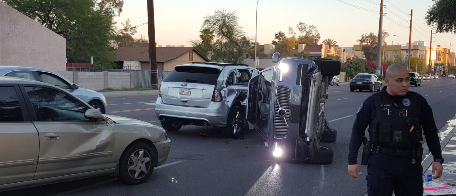 A self-driven Volvo SUV owned and operated by Uber Technologies Inc. is flipped on its side after a collision in Tempe, Arizona, U.S. on March 24, 2017. [FRESCO NEWS/Mark Beach/Handout via REUTERS]