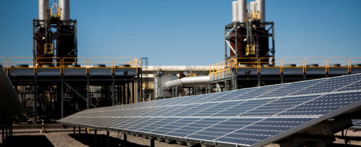 FILE PHOTO: Solar panels are seen in front of a natural gas power plant at the Tahoe-Reno Industrial Center in McCarran, Nevada, U.S., September 16, 2014. REUTERS/Max Whittaker | Vermont Reduces Solar Subsidies