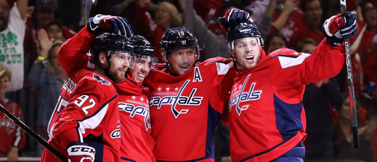 WASHINGTON, DC - MAY 21: T.J. Oshie #77 of the Washington Capitals celebrates his second period goal against the Tampa Bay Lightning with teammates in Game Six of the Eastern Conference Finals during the 2018 NHL Stanley Cup Playoffs at Capital One Arena on May 21, 2018 in Washington, DC. (Photo by Patrick Smith/Getty Images)