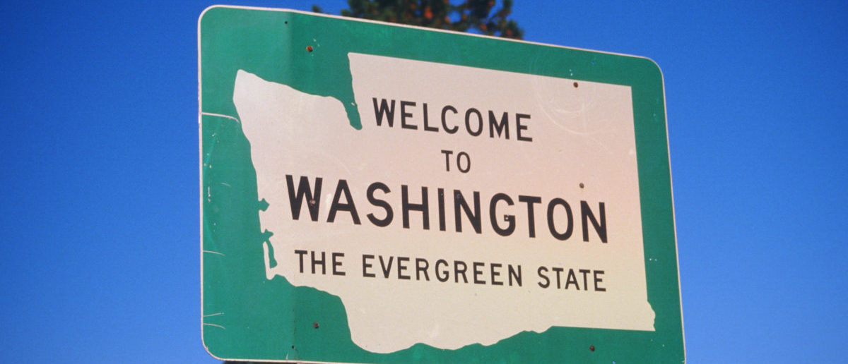 "Sign welcoming travelers to the ""evergreen"" state of Washington. ShutterStock - Joseph Sohm"