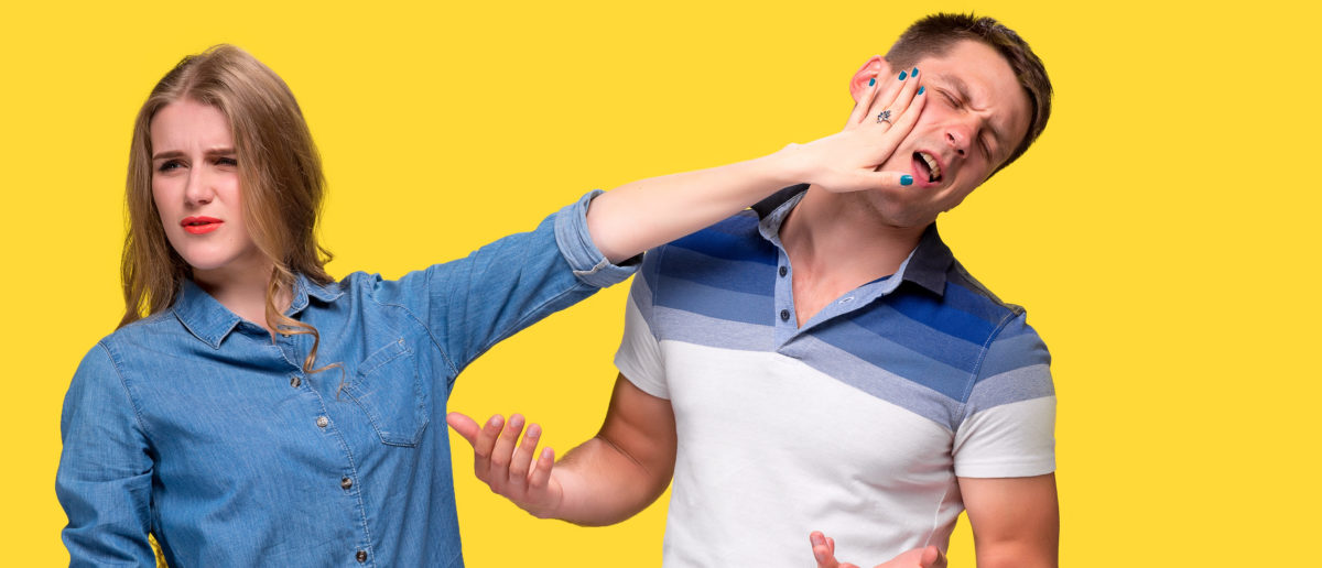 Woman slapping man in the face (Shutterstock/Master1305) | Feds Probe Yale For Excluding Men