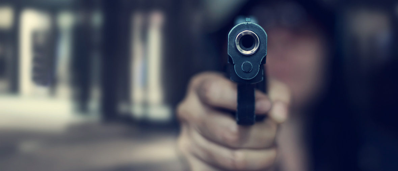 Woman with gun:Shutterstock | 70-Year-Old Grandma Shoots Home Intruder