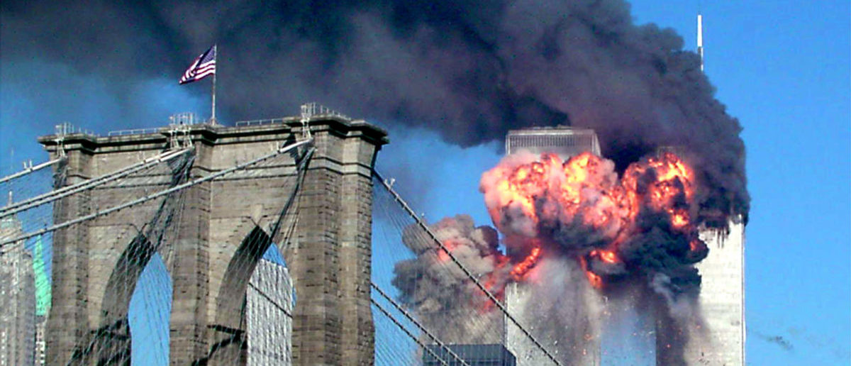 Both towers of the World Trade Center burn on Sept. 11, 2001. REUTERS/Sara K. Schwittek.