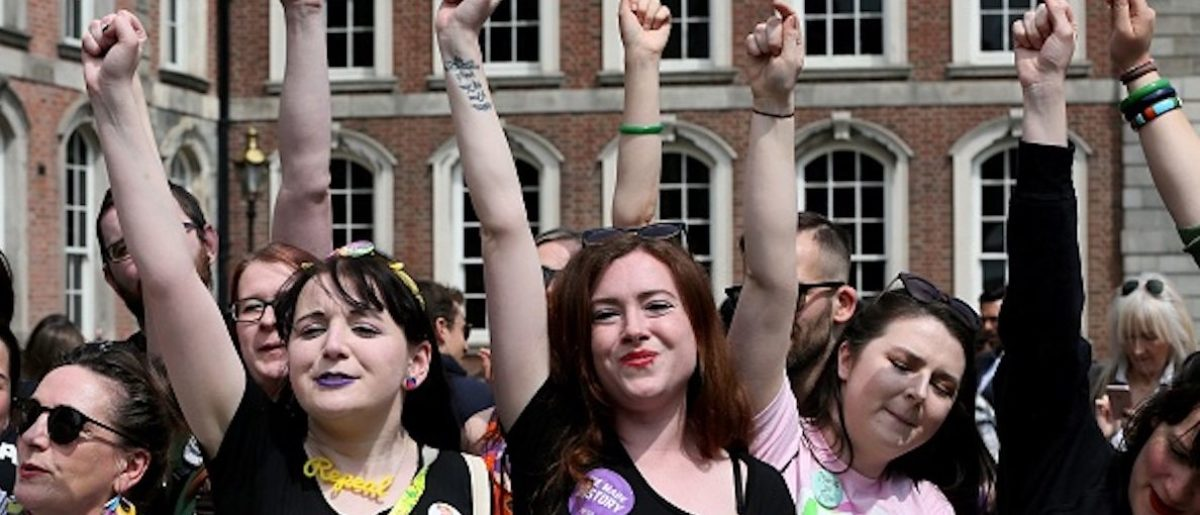 Yes campaigners jubilate as they wait for the official result of the Irish abortion referendum, at Dublin Castle in Dublin on May 26, 2018. - The first official results declared in Ireland's historic referendum on its strict abortion laws, showed 60 percent in the Galway East constituency backed repealing the constitutional ban on terminations. (Photo by Paul FAITH / AFP) (Photo credit should read PAUL FAITH/AFP/Getty Images)