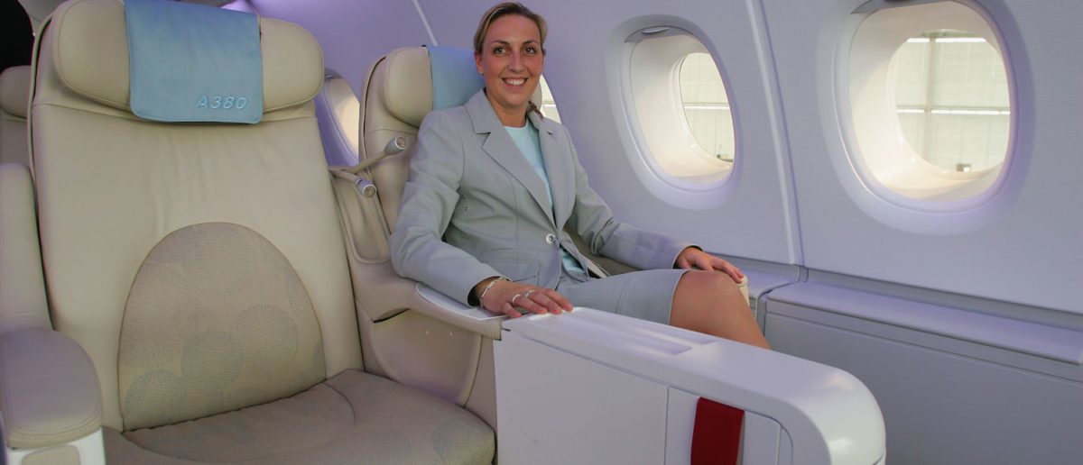 A woman sits in business class for flight. (Photo: Andreas Rentz/Getty Images)   Fmr DHSer Dinged For Nepotism, Travel