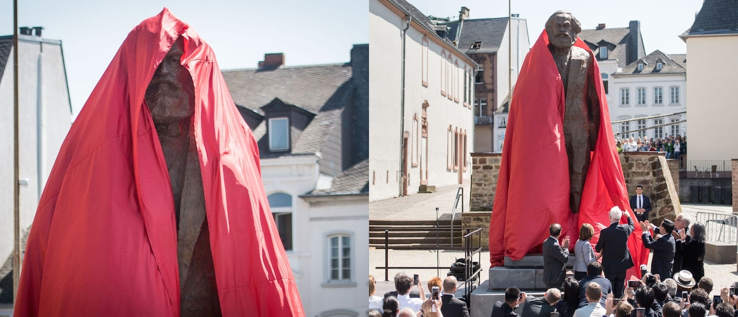 The sculpture of German philosopher and revolutionary Karl Marx is uncovered during its inauguration at the 200th anniversary of the birth of Karl Marx on May 5, 2018 in Trier, Germany. The bronze statue, by Chinese artist Wu Weishan, is weighing 2,3 tons and measures 4,40 meters. It is a present of the People's Republic of China. (Photos: Thomas Lohnes/Getty Images)