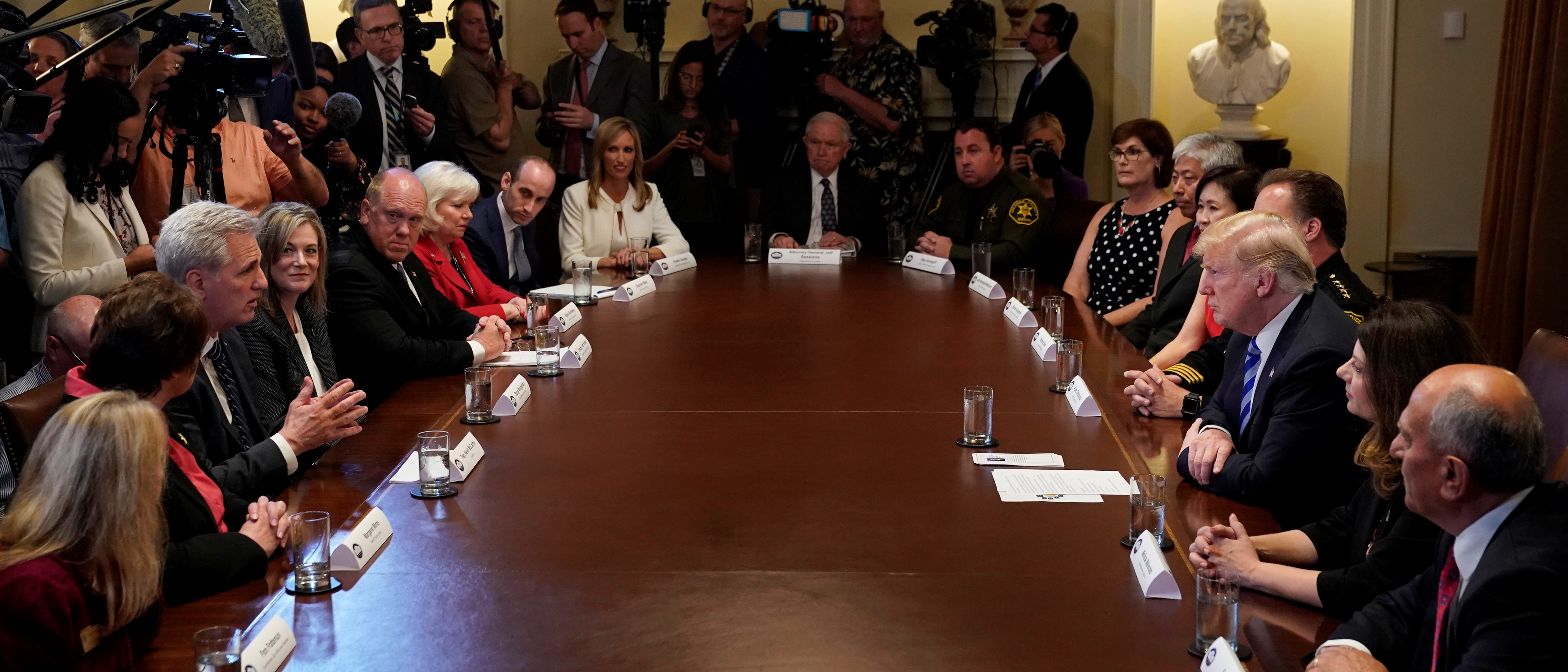 "U.S. President Donald Trump listens to House Majority Leader Kevin McCarthy (L) speak during a ""California Sanctuary State Roundtable"" at the White House in Washington. U.S., May 16, 2018. REUTERS/Kevin Lamarque - RC1F5782D470"