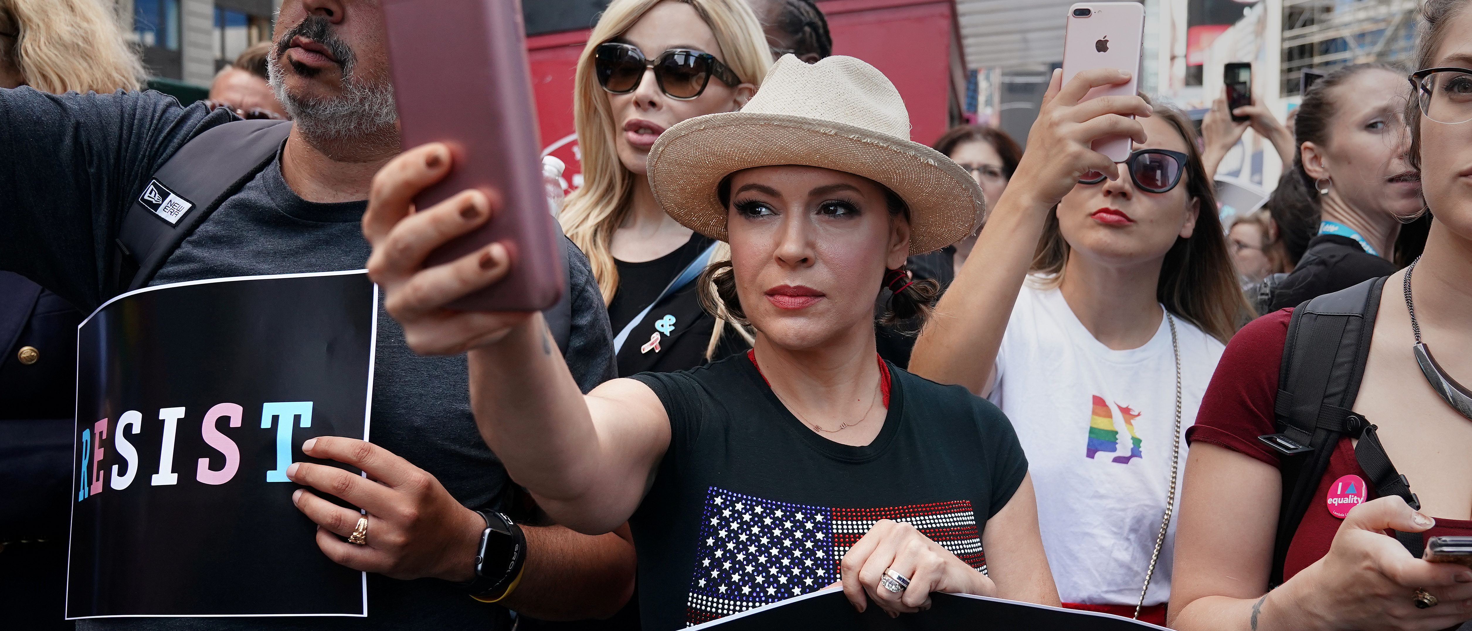 Actress Alyssa Milano attends a protest against U.S. President Donald Trump's announcement that he plans to reinstate a ban on transgender individuals from serving in any capacity in the U.S. military, in Times Square, in New York City, New York, U.S., July 26, 2017. REUTERS/Carlo Allegri - RC1BA409A7E0