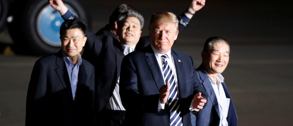The three Americans formerly held hostage in North Korea gesture next to U.S.President Donald Trump, upon their arrival at Joint Base Andrews, Maryland, U.S., May 10, 2018. REUTERS/Jim Bourg | Trump Freed 17 Prisoners Detained Abroad