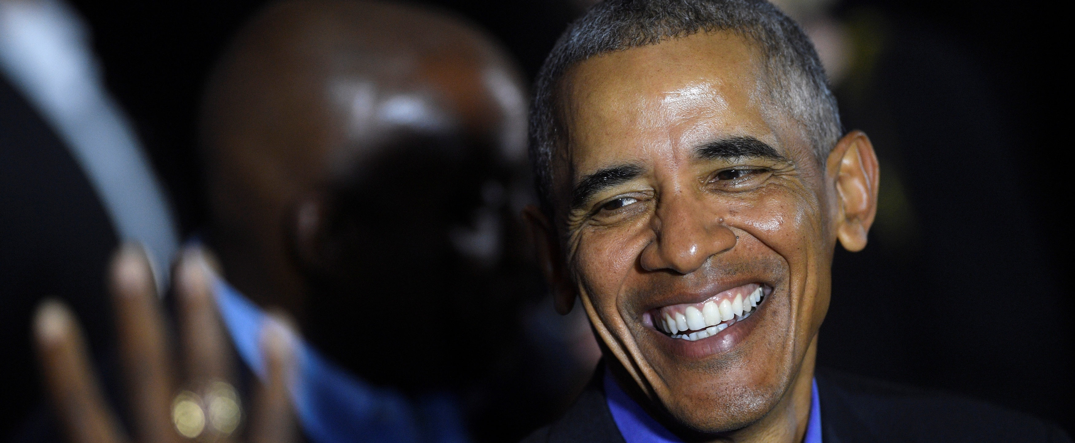 Former President Barack Obama greets supporters after joining New Jersey Democratic Gubernatorial candidate Jim Murphy at a rally in Newark, New Jersey U.S. October 19, 2017. REUTERS/Mark Makela