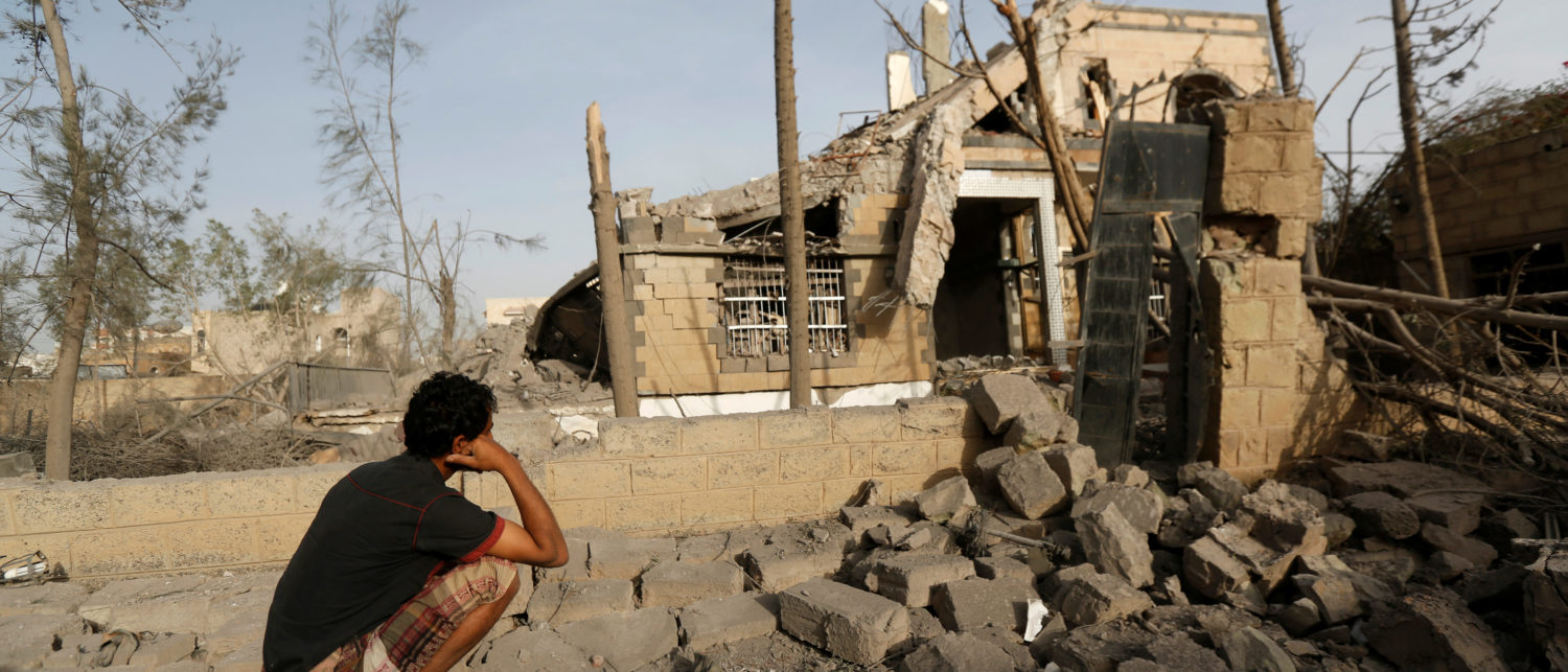 A man sits in front of a house destroyed by air strikes in Sanaa, Yemen June 6, 2018. REUTERS/Khaled Abdullah - RC1182083EA0