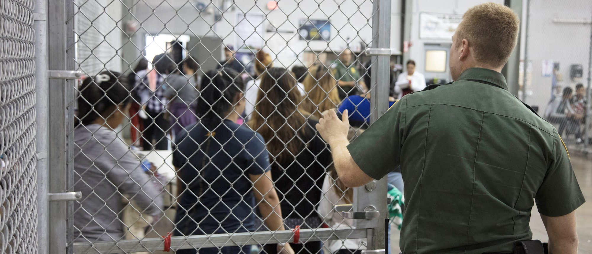A view of inside U.S. Customs and Border Protection (CBP) detention facility shows detainees inside fenced areas at Rio Grande Valley Centralized Processing Center in Rio Grande City, Texas, June 17, 2018. Courtesy CBP/Handout via REUTERS