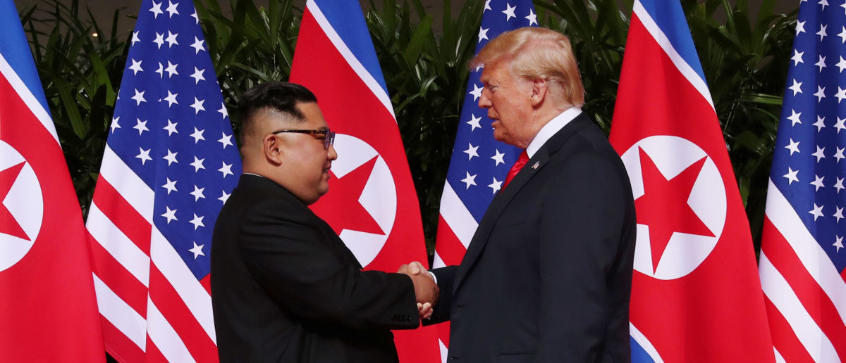 Donald Trump and Kim Jong Un Shake Hands  e