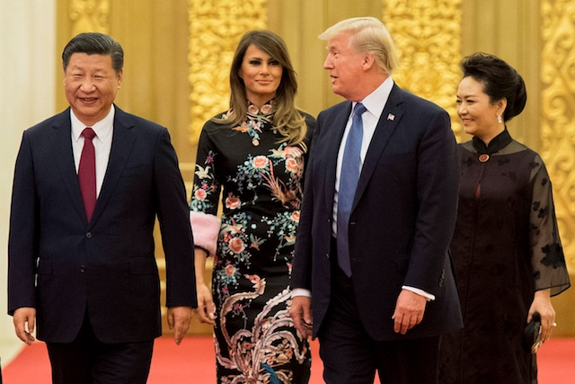 "US President Donald Trump (2nd R) speaks to China's President Xi Jinping (L), as US First Lady Melania Trump (2nd L) and Xi's wife Peng Liyuan (R) look on, the Great Hall of the People in Beijing on November 9, 2017. Donald Trump urged Chinese leader Xi Jinping to work hard and act fast to help resolve the North Korean nuclear crisis during talks in Beijing Thursday, warning that ""time is quickly running out"". (Photo credit: JIM WATSON/AFP/Getty Images)"