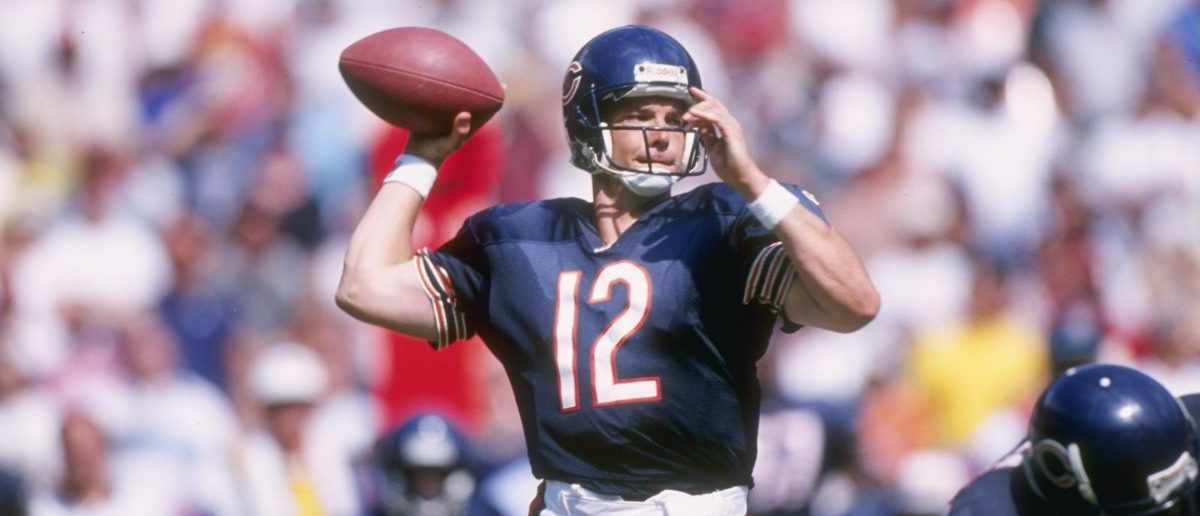 8 Sep 1996: Quarterback Erik Kramer #12 of the Chicago Bears looks down field for an open receiver as he sets his feet to throw a pass during the Bears 10-3 loss to the Redskins at RFK Stadium in Washington D.C. (Mandatory Credit: Doug Pensinger /Allspor/ Getty Images)