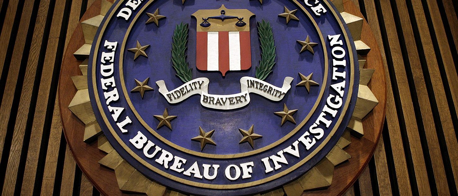 The seal of the F.B.I. hangs in the Flag Room at the bureau's headquaters March 9, 2007 in Washington, DC. F.B.I. Director Robert Mueller was responding to a report by the Justice Department inspector general that concluded the FBI had committed 22 violations in its collection of information through the use of national security letters. The letters, which the audit numbered at 47,000 in 2005, allow the agency to collect information like telephone, banking and e-mail records without a judicially approved subpoena. (Photo by Chip Somodevilla/Getty Images)