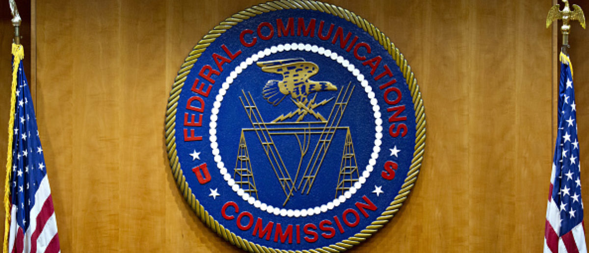The Federal Communications Commission (FCC) seal hangs inside a meeting room at the headquarters ahead of a open commission meeting in Washington, D.C., U.S., on Thursday, Dec. 14, 2017. The FCC is slated to vote to roll back a 2015 utility-style classification of broadband and a raft of related net neutrality rules, including bans on broadband providers blocking and slowing lawful internet traffic on its way to consumers. (Photo: Andrew Harrer/Bloomberg via Getty Images)
