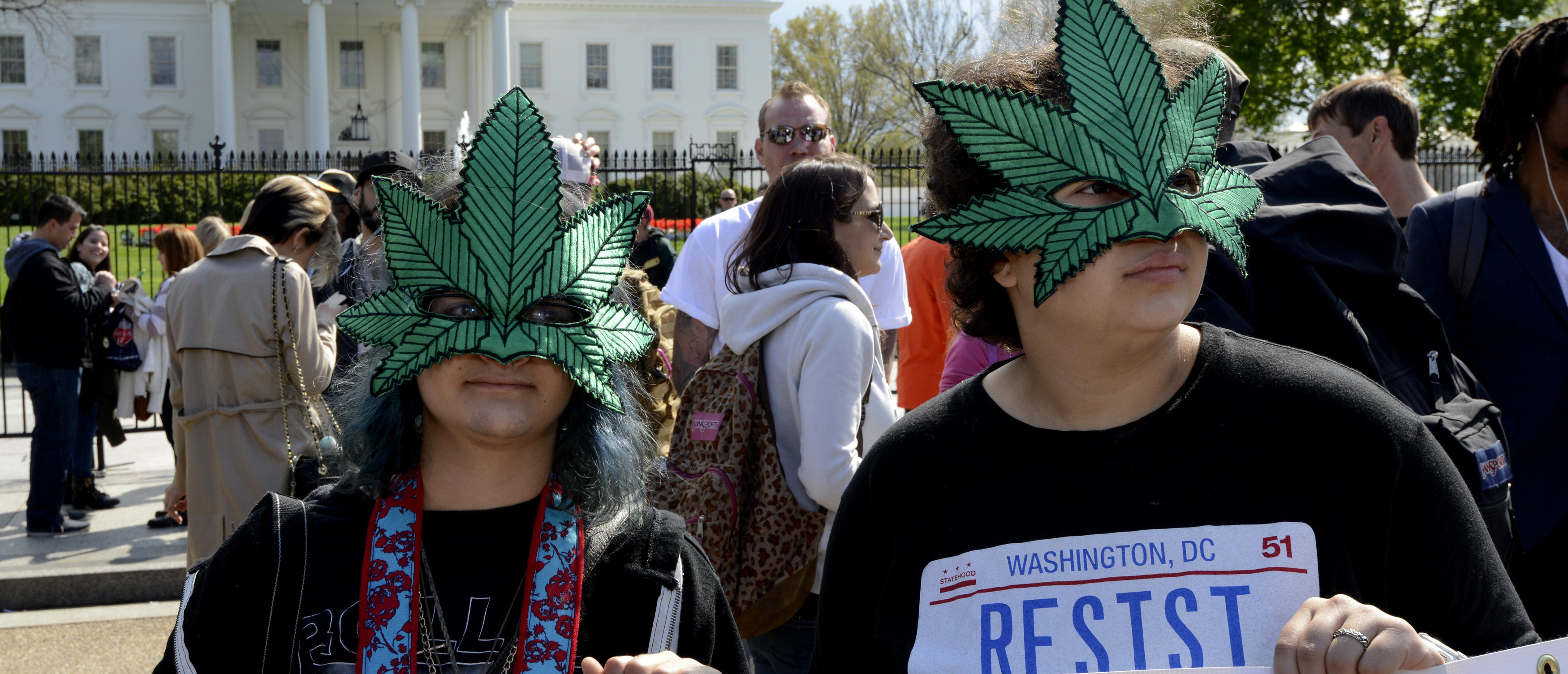 Jasmine Garcia (L) and Sal Ortiz, both of Washington, wear marijuana leaf masks as they join dozens of protestors for the legalization of marijuana in front of the White House, April 2, 2016, in Washington, DC. Many called for the de-criminalization of pot and pointed to the medical benefits. At least two smokers were cited with mere possession, a $25 fine in the District of Columbia. / AFP / Mike Theiler (Photo credit should read MIKE THEILER/AFP/Getty Images)