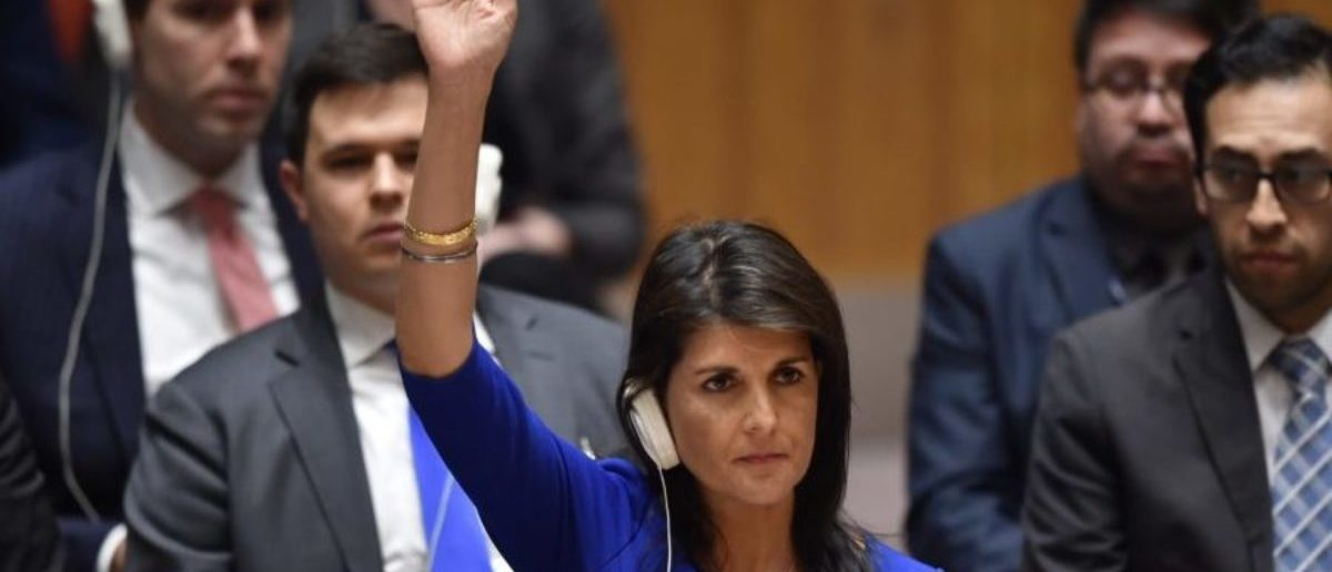 US Ambassador to the UN Nikki Haley votes during a UN Security Council meeting, at the United Nations Headquarters in New York, on April 14, 2018. - Russia on Saturday failed to win UN backing for a condemnation of military strikes launched by the United States, Britain and France on Syria in retaliation for an alleged chemical weapons attack. (Photo by HECTOR RETAMAL / AFP) (Photo credit should read HECTOR RETAMAL/AFP/Getty Images)