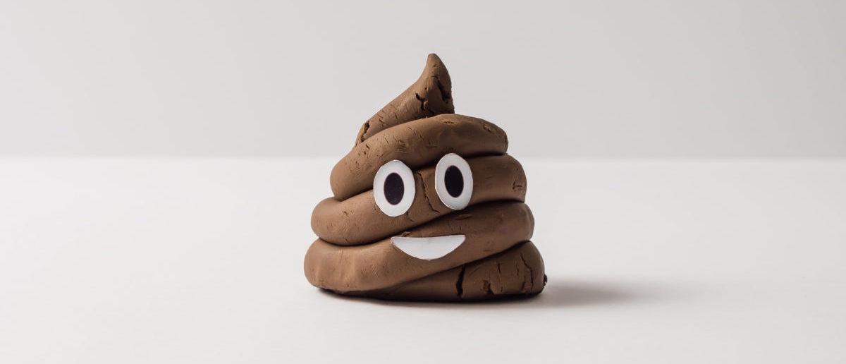 Poop emoticon on bright background. (Image: Shutterstock.com)