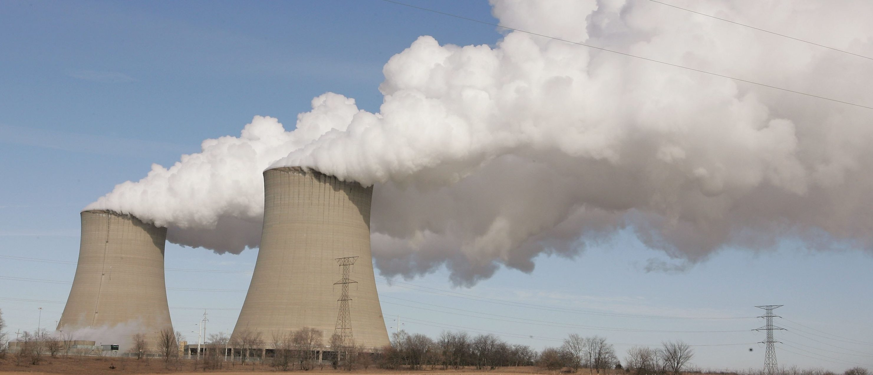 BYRON, IL - FEBRUARY 17: Steam billows from the cooling towers at Exelon's nuclear power generating station February 17, 2006 in Byron, Illinois. Elevated levels of radioactive tritium have been found in water leaked from the facility as well as two other nuclear power generating facilities owned by Exelon in the state. Tritium has been linked to cancer and birth defects. Exelon operates nuclear power units at in Illinois, Pennsylvania and New Jersey. (Photo by Scott Olson/Getty Images)